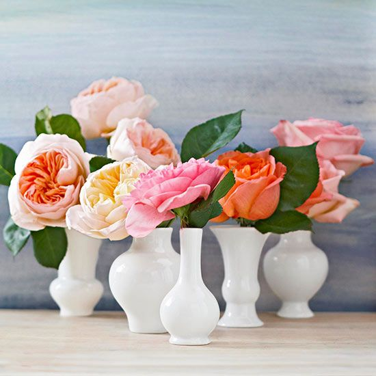 Create a Valentine's Day display using small bud vases to make a non-traditional floral arrangement.