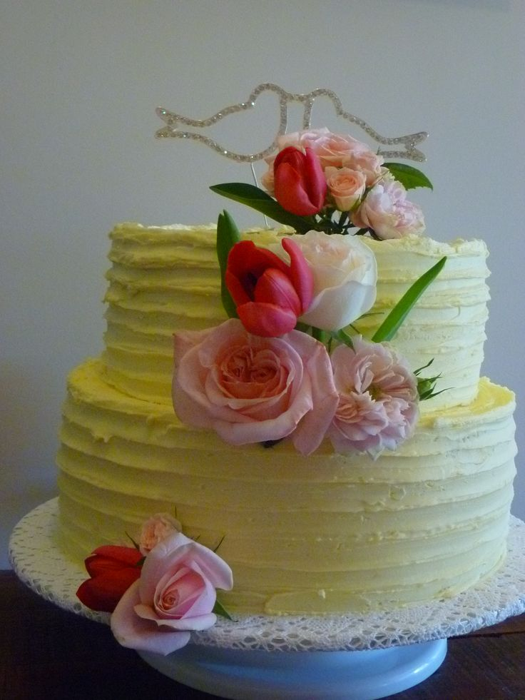 Classic Vintage Wedding Cake.  2 tiered frosted wedding cake.