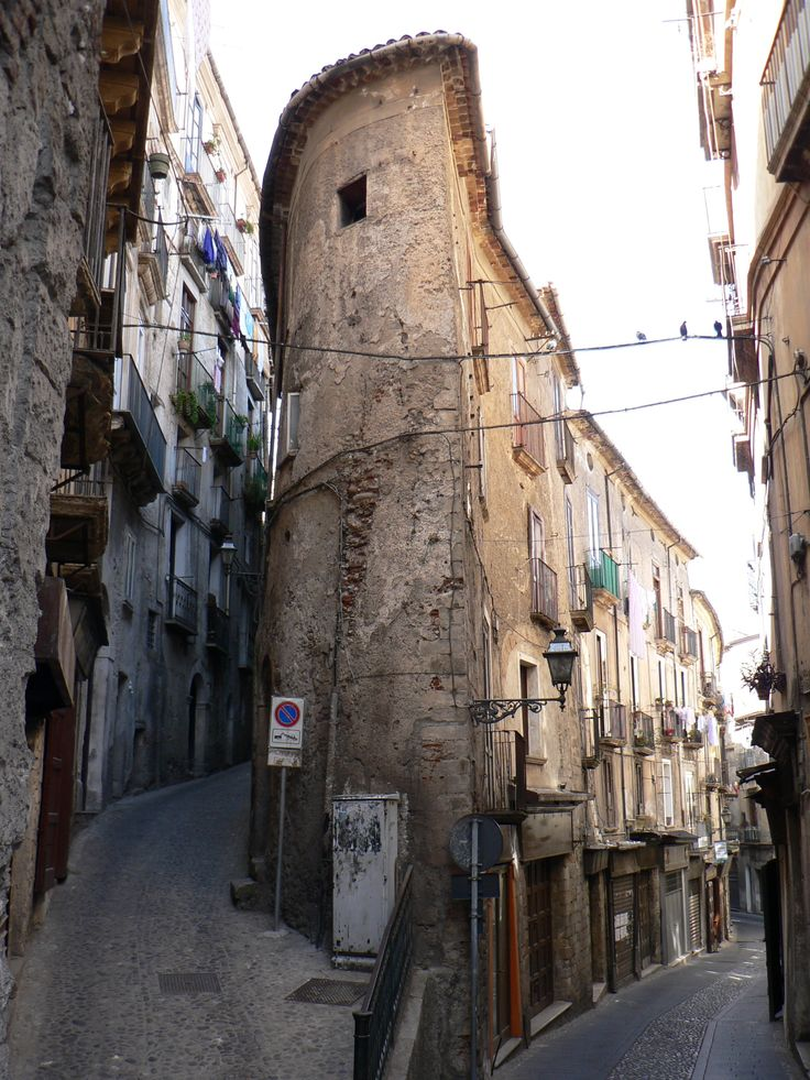 Cosenza, Calabria  I love the way that buildings used to be built to fit the space available.  It's hell to find an address - but SO much more interesting!
