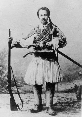 Φωτογραφία του Θεόφιλου Χατζημιχαήλ με φουστανέλα. Τέλη 19ου αι. Συλλογή Μουσείου Θεόφιλου. Theophilos Hatzimihail wearing fustanella costume. Late 19th c. Theofilos Museum collection