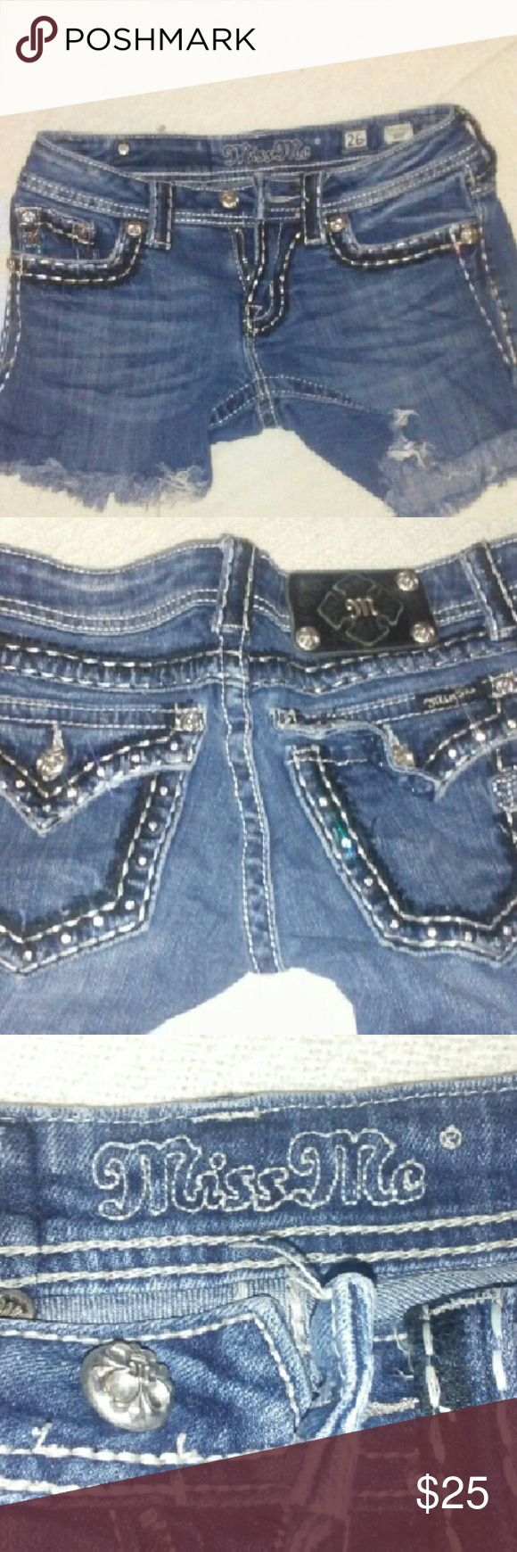 Miss Me women's cut off denim shorts size 26 Gently used Miss Me cut off denim shorts with black and silver embellishments. Super sexy yet tasteful. Pair with distressed black stockings for a fall look. Size 26 Miss Me Shorts Jean Shorts