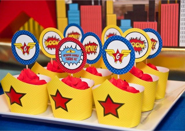 Adorable Wonder Woman Party Cupcakes - Printable Cupcake wrappers in the shape of Wonder Woman's headband!
