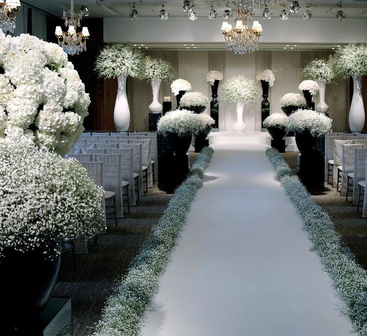Baby's breath abounds in this Chanel-inspired ceremony setup.