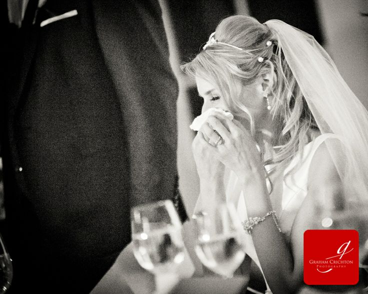 Bride wiping a tear from her eyes during wedding speeches www.grahamcrichton.com