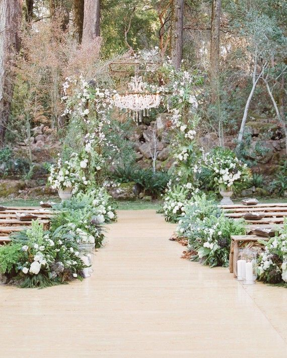 Adriana and Han exchanged vows in front of an archway of ferns and white…