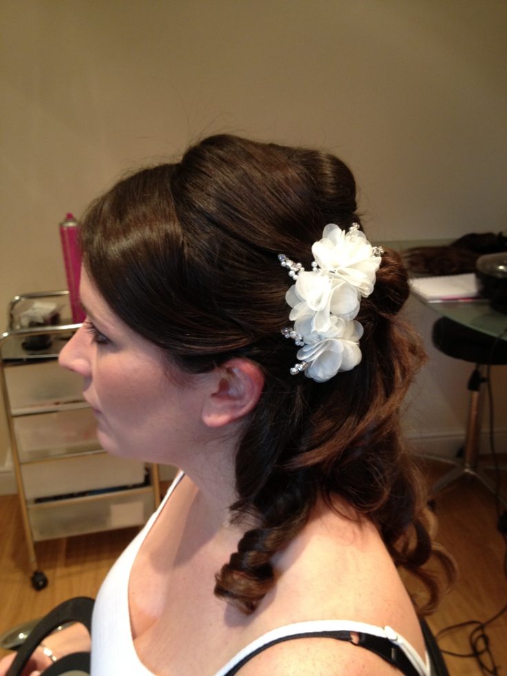 Half up with flower.. www.RiotHairdressing.co.uk  Rehearsal pictures. Nothing is polished, but they're great for brides to get some ideas on shape and what their hair will and won't do! Look at our other boards for perfect Bridal Hair when polished!! Curls, Hair up, wedding hair, extensions. Bridesmaids. Asymmetric, bun, soft, Pleat, wavy, pearl pins, tiara, plaits, boho, woven, lattice, sworvski crystal flower, tweed, braid