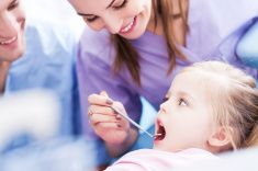 Little girl at the dentist stock photo