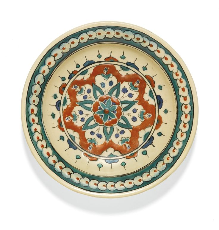 An Iznik polychrome pottery dish with a stylised stellar floral motif, Turkey, circa 1580-90 | Lot | Sotheby's
