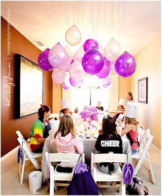 Instead of spending money on helium hang balloons from strings  on the ceiling. It  creates the same look.