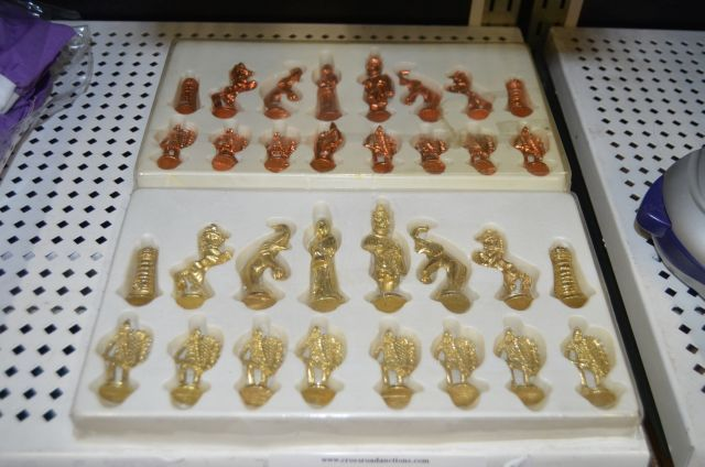 Complete diecast brass and copper chess set