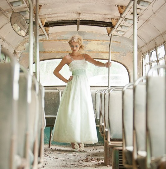 a vintage 1950's prom dress as a wedding dress...how cute is that?!?!  :)