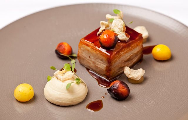 Richard Davies uses old and new techniques to create a stunning pork belly dish, accompanying with baked apple and celeriac purées, carrots and crackling