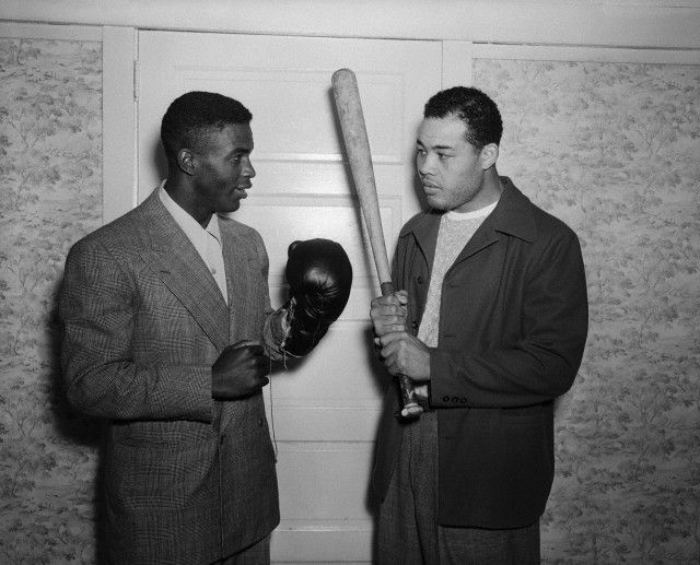 Jackie Robinson and Joe Louis compare notes, and the tools of their respective trades, on June 14, 1946 during Mr. Robinson's visit to Mr. Louis's training camp in Pompton Lake, New Jersey. It was 66 years ago today, on April 15, 1947, that Jackie Robinson broke the color barrier in Major League Baseball to play with the Brooklyn Dodgers. Photo: Bettman/Corbis.