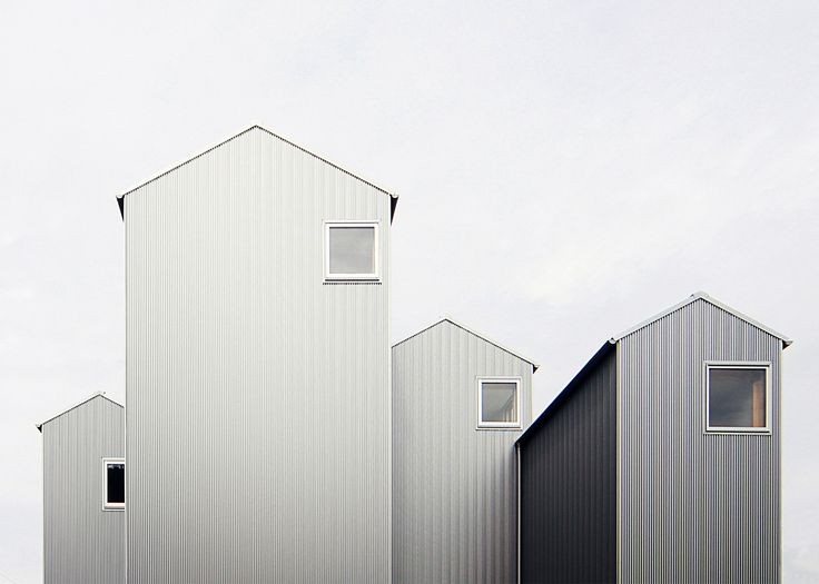 House in Kosai, Japan by Shuhei Goto Architects - These four house-shaped volumes may look like individual homes but they actually define different areas of the same residence by Shuhei Goto Architects
