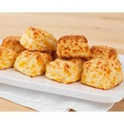 Easy-Bake Cheddar Biscuits Allrecipes.com - excellent. I used pastry flour anda dded a dash of garlic.  fluffy, nice flavour. will make again