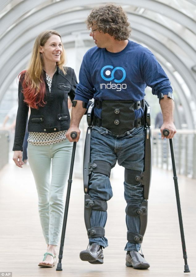 Paraplegic Peter Anziano walks besides his wife Melissa Ford in an 'exoskeleton' manufactured by the US company 'Parker Hannifin Corporation' of Cleveland
