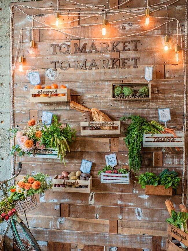 Foodie wedding. Photo display with favorite farm foods. Edison bulbs and wood crates.