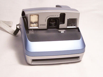 Polaroid One600 Classic Instant Film Camera- to take pictures of guests to put into guest book. Guest write in the caption space on the film.