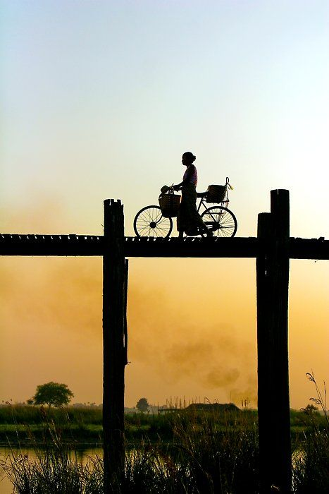 """going home"" an amazing capture of a woman in amarapura, burma on the longest teak bridge in the world"