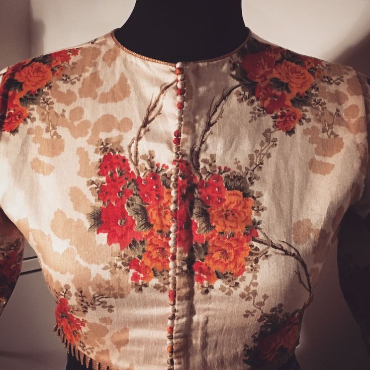 Printed silk high neck blouse. get it done at http://mytailor.in/