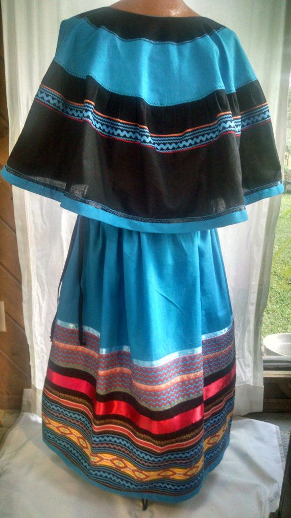 2-piece outfit is a simple style, that does NOT have Seminole-type patchwork. It is the traditional style used by Muskogee Creek, Yamassee and