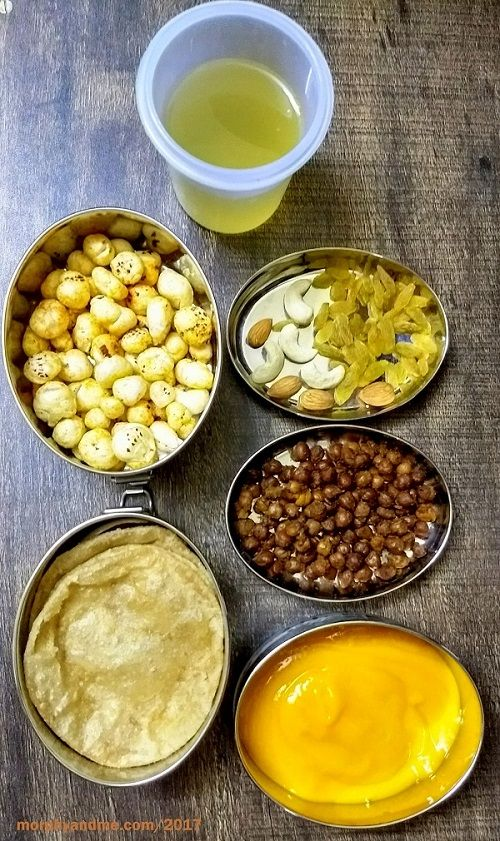 Lunchbox Ideas 7 has a crunchy combination of makhana pops and dry fruits for snack along with jaggery cooler. And for Lunch poori, kala channa and aamras.