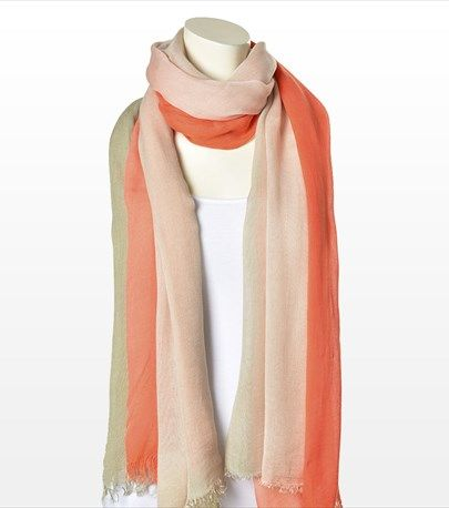 This beautiful coral gradient scarf will add the final touch to your spring look.