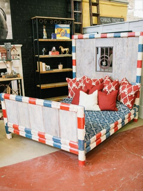 Mike took the salvaged horse beams and upcycled them into this eclectic bed frame.