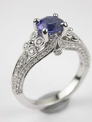 Blue Sapphire Engagement Ring. I love that it is not your typical diamond ring