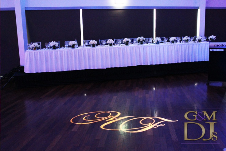 Bridal Table & Custom Monogram at Moda Events Portside | G&M DJs | Magnifique Weddings #gmdjs #magnifiqueweddings #weddinglighting #weddingdjbrisbane #modawedding #modaevents @gmdjs @modaeventsvenue
