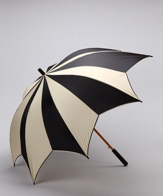 love this umbrella!   It reminds me of Nightmare Before Christmas.. very gothic and cartoony.   <3