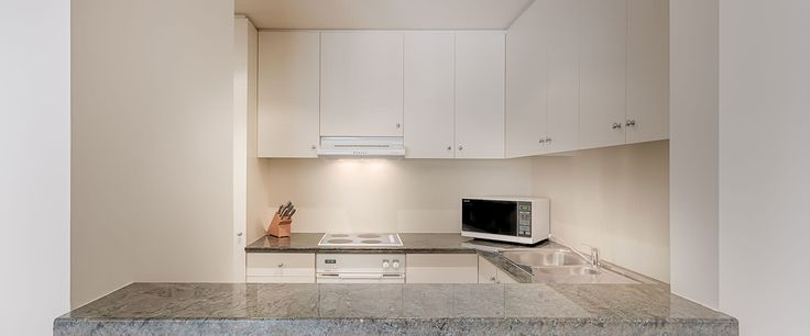 Caroline Serviced Apartments South Yarra - Two Bedroom Premium apartment kitchen