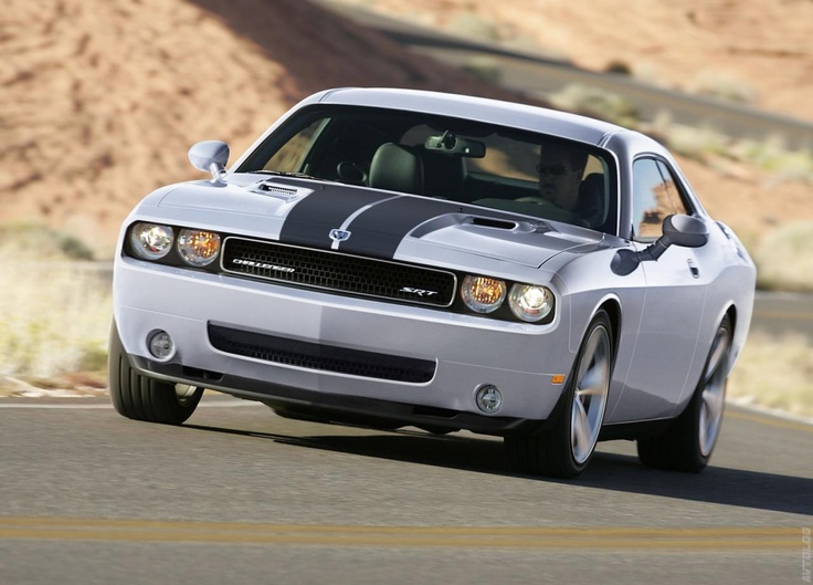 2009 Dodge Challenger SRT8 Silver I love driving ours...if only my dad would let me drive it more...