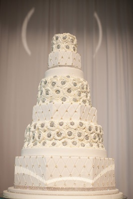 At the same time the curtain drop revealed the band, traveling drapes parted to reveal the beautiful wedding cake.