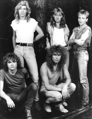 Def Leppard. My 2nd favorite band of all time. Went to see them in concert with KISS. Def was definitely the highlight of the show! (Kiss...well...was not...) Would love to see them again! They might be getting old but they sure as heck don't sound like it!!!