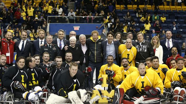 Prince Harry with Canadian Prime Minister Justin Trudeau (centre right) with sledge hockey athletes at the Mattamy Centre