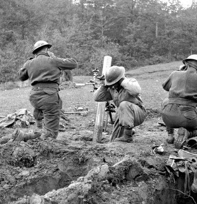 Canadian troops firing a mortar in the vicinity of the Sangro River in November 1943. PAC Photo.  www.canadiansoldiers.com