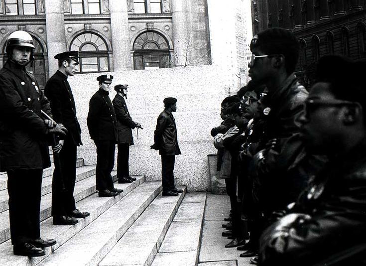 Cops and Black Panthers on Court house steps for the Panther 21 trial - NYC - 1969: