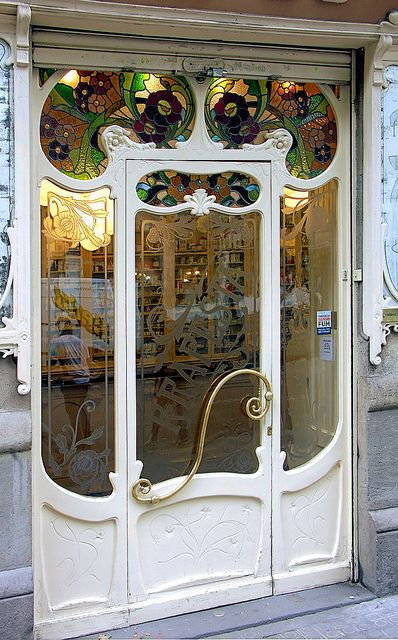 Catalonian Modernisme, Entry door to a Chemist, Villarroel 053 b, Barcelona - Spain   by Arnim Schulz, via Flickr