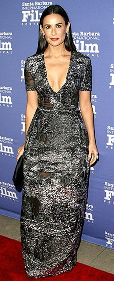 Demi Moore hit the red carpet in a voluminous silver gown with a plunging neckline.