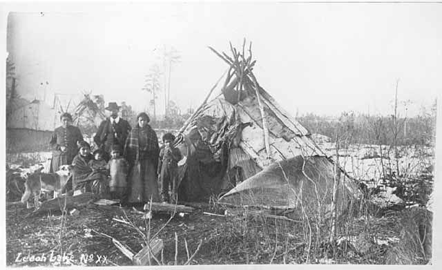 Ojibway wigwam and family, Leech Lake, MN. Photograph Collection, 1900 Minnesota Historical Society