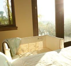 Original Co-Sleeper® in Natural: The Original Co-Sleeper® brand bassinet safely attaches to adult-sized beds.