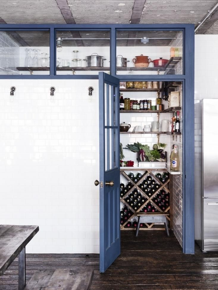 Organized kitchen pantry and wine cellar in London home.