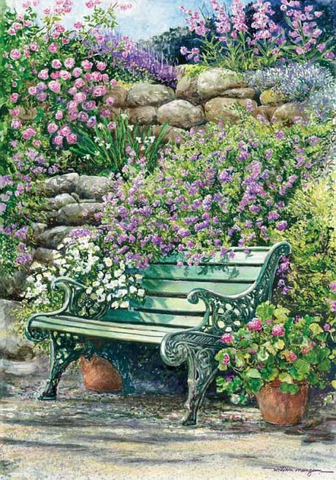 Green wrought iron bench surrounded by flowers