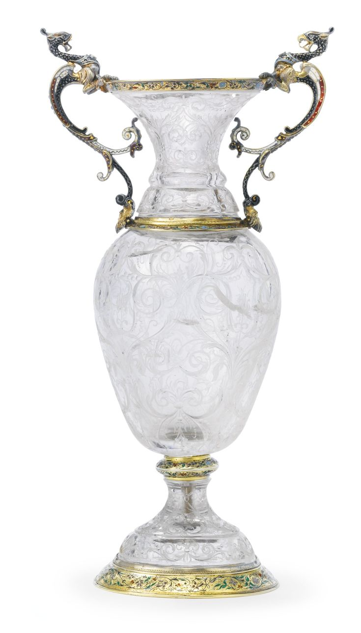 AN AUSTRIAN SILVER-GILT AND ENAMEL MOUNTED ROCK CRYSTAL VASE, HERMANN…