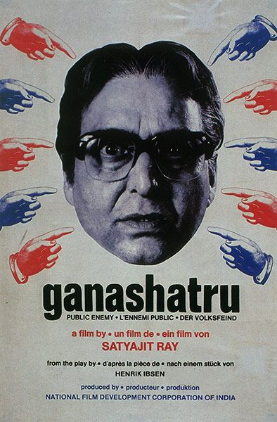 "Ganashatru (The Enemy of the People), 1989: In the poster for Satyajit Ray's penultimate film, the fingers pointing at the doctor protagonist symbolize the crowds of people and big businesses denouncing the character as a heretic after he discovers that the ""holy water"" of the temple is, in fact, polluted and killing local people. Based on an Ibsen play of the same name, the film had to be shot in studios due to the director's deteriorating health."