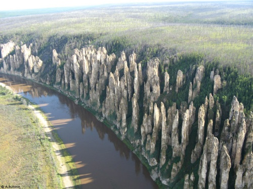 The geological formations known as the Lena Pillars have fascinated  travellers since the 17th century. About 140km upriver from  Yakutsk, the rock of the cliffs alongside the       river has been  eroded away into delicate shapes of a reddish brown colour.
