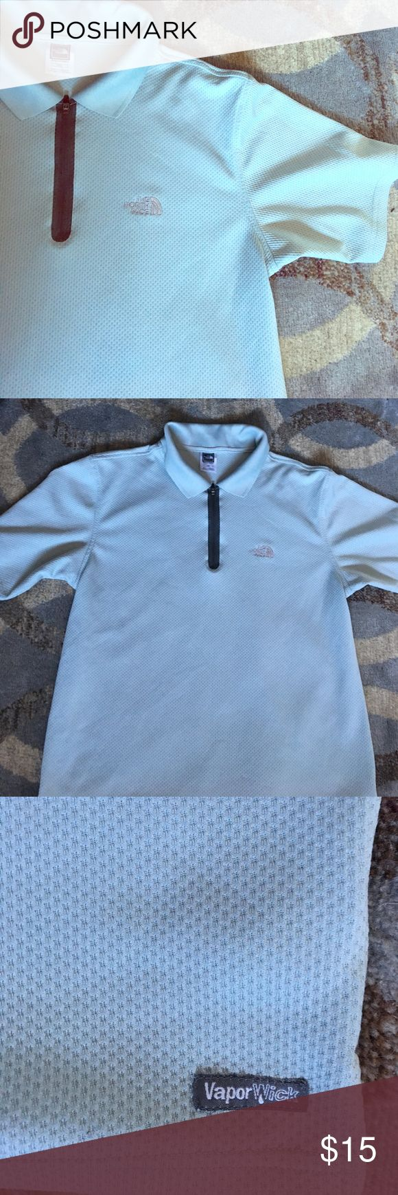The North Face polo collared shirt Gently used. No flaws The North Face Shirts Polos