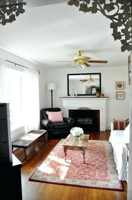 long narrow living room with fireplace on end wall ...