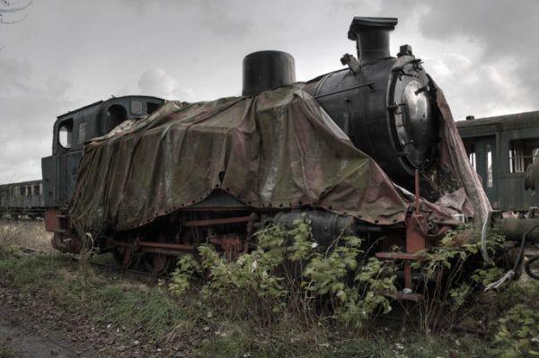 Old steam locomotive in Baasrode. Abandoned rail yard, Reihagenstraat / Fabrieksstraat, Baasrode, Belgium.
